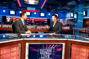 Photo - Joe Schad, left, interviews Oklahoma State football coach Mike Gundy on the set of College Football Live on Monday in Bristol, Conn. Photo courtesy ESPN