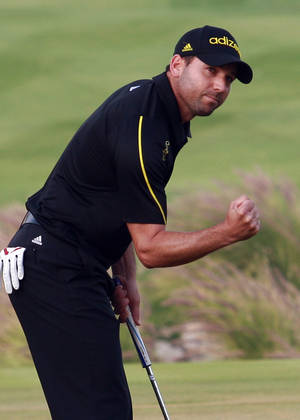photo - Spain's Sergio Garcia gestures during the final round of the Qatar Masters Golf Tournament in the capital Doha, Qatar, Saturday, Jan. 26, 2013. (AP Photo/Osama Faisal)