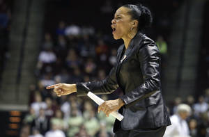 Photo - South Carolina coach Dawn Staley reacts during the second half of her team's NCAA college basketball game against Texas A&M, Thursday, Jan. 16, 2014, in College Station, Texas. (AP Photo/Patric Schneider)