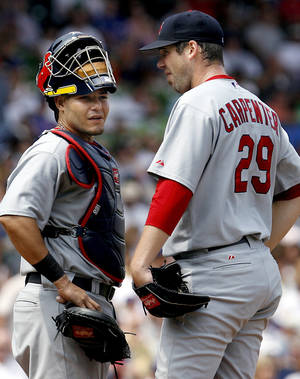 Photo - Catcher Yadier Molina, left, and pitcher Chris Carpenter are the only Cardinals left from their 2004 World Series team. AP photo