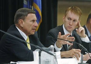 Photo - Congressman John Mica, R-Fla., chairman of the U.S. House Committee on Transportation and Infrastructure, gestures as he speaks during a field hearing in Oklahoma City. Congressman James Lankford, R-Oklahoma, is at right. AP PHOTO