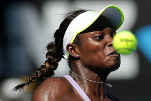 Photo - Sloane Stephens of the US hits a forehand return  to Victoria Azarenka of Belarus during their semifinal match at the Australian Open tennis championship in Melbourne, Australia, Thursday, Jan. 24, 2013. (AP Photo/Aaron Favila)