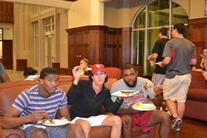 "Photo -  OU linebacker Eric Striker, right, eats with fellow students during a ""late-night breakfast"" event at Headington Hall last year. PHOTO PROVIDED  <strong></strong>"