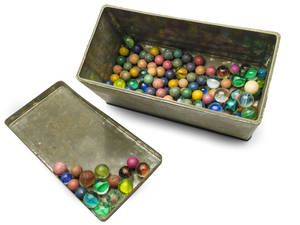 Photo - This Nov. 14, 2013 photo provided by the Anne Frank House Amsterdam on Tuesday, Feb. 4, 2014, shows a set of marbles belonging to Anne Frank. Shortly before Anne Frank and her family went into hiding from the Nazis, she gave away some of her toys to non-Jewish neighborhood girlfriend Toosje Kupers for safekeeping. The toys have now been recovered and Anne's tin of marbles will go on display for the first time this week at an art gallery in Rotterdam, the Anne Frank House Museum says. (AP Photo/Anne Frank House Amsterdam, Diederik Schiebergen))