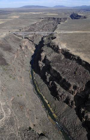 photo - This undated photo shows the Rio Grande Gorge Bridge within the proposed El Rio Grande Del Norte National Conservation Area near Taos, N.M. The White House says President Obama will designate as national monuments Monday March 25, 2013, the Río Grande del Norte National Monument in New Mexico; First State National Monument in Delaware; Harriet Tubman Underground Railroad National Monument in Maryland; Charles Young Buffalo Soldiers National Monument in Ohio; and San Juan Islands National Monument in Washington state. (AP Photo/Albuquerque Journal, Greg Sorber)