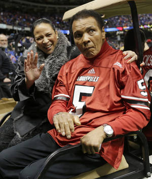 photo - FILE - In this Jan. 2, 2013, file photo, former boxing legend Muhammad Ali arrives at the Sugar Bowl football game in New Orleans. Muhammad Ali's daughter knocked down rumors of her father being near death Sunday, Feb. 3, 2013, saying he was at home watching NFL football's Super Bowl. (AP Photo/Dave Martin, File)
