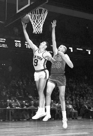 Photo - FILE - This December 1959 file photo shows New York Knickerbockers' Richie Guerin (9) and Syracuse Nationals' Connie Dierking (20) during a basketball game at Madison Square Garden in New York.  Dierking has died at 77. His death was announced Monday, Dec. 30, 2013, by WKRC-TV, where his daughter Cammy Dierking is a news anchor. Dierking had been a 1958 first round pick of the Syracuse Nationals, and also played for the Philadelphia 76ers and San Francisco Warriors for more than a decade in the NBA. (AP Photo/John Lent, File)