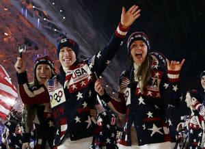 Photo - The United States team arrives during the opening ceremony of the 2014 Winter Olympics in Sochi, Russia, Friday, Feb. 7, 2014. (AP Photo/Patrick Semansky)