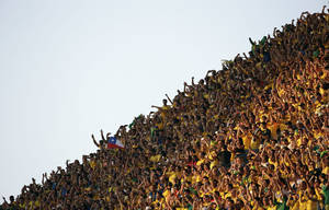 Photo - Fans cheer before the group A World Cup soccer match between Brazil and Croatia, the opening game of the tournament, in the Itaquerao Stadium in Sao Paulo, Brazil, Thursday, June 12, 2014.  (AP Photo/Felipe Dana)