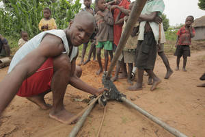 photo - An African man works to obtain water through a Water4 Foundation project. The Oklahoma City-based nonprofit is hosting a holiday contest. <strong>PROVIDED</strong>