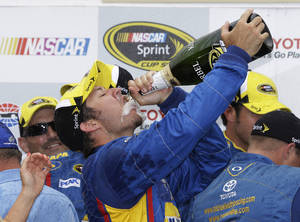 Photo - Martin Truex Jr. celebrates after winning the NASCAR Sprint Cup series auto race on Sunday, June 23, 2013, in Sonoma, Calif. (AP Photo/Eric Risberg)