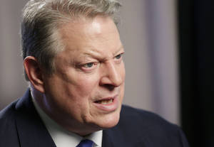 "Photo - Former U.S. Vice President Al Gore talks during an interview, Tuesday, Jan. 29, 2013 in New York. Gore, who takes aim in his new book at the corporate media for ""suffocating the free flow of ideas,"" on Tuesday defended the sale of his own television channel to Al-Jazeera. (AP Photo/Mark Lennihan)"