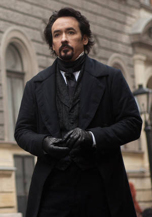 "Photo - John Cusack portrays Edgar Allan Poe in a scene from the gothic thriller ""The Raven.""  RELATIVITY MEDIA PHOTO <strong>Larry Horricks</strong>"