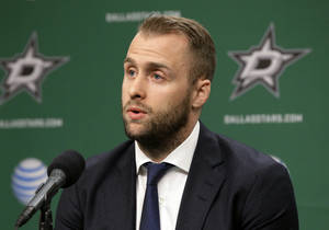 Photo - Dallas Stars center Rich Peverley responds to questions during a news conference before the Stars' NHL hockey game against the Nashville Predators, Friday, March 28, 2014, in Dallas. Peverley collapsed on the bench during a game earlier this month. He then had surgery to correct an abnormal heart rhythm. (AP Photo/Tony Gutierrez)