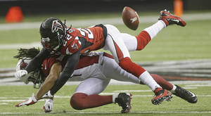 Photo -   Atlanta Falcons cornerback Asante Samuel (22) breaks up a pass intended for Arizona Cardinals wide receiver Larry Fitzgerald (11) during the first half of an NFL football game Sunday, Nov. 18, 2012, in Atlanta. (AP Photo/John Bazemore)