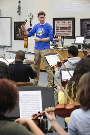 Photo - Edmond teacher of the year Peter Markes leads his Edmond North High School Orchestra students. Photo By David McDaniel, The Oklahoman <strong>David McDaniel - The Oklahoman</strong>