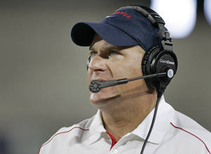 Photo -   Arizona head coach Rich Rodriguez watches the play of his team on the field against Toledo in his first game as Arizona's head football coach during the first half of an NCAA college football game at Arizona Stadium in Tucson, Ariz., Saturday, Sept. 1, 2012. (AP Photo/John Miller)