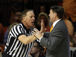 Photo - OSU coach Travis Ford argues a call during a Feb. 22 matchup against Texas Tech.