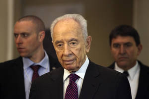 Photo - Israeli President, Shimon Peres, arrives to give a brief statement at the World Economic Forum, in Southern Shuneh, 34 miles (55 kilometers) southeast of Amman, Jordan, Sunday, May 26, 2013. Peres says it is possible for Israelis and Palestinians to overcome differences and skepticism over peacemaking and that it is time to restart serious negotiations and conclude a peace treaty that has long dogged the two warring sides. AP Photo/Mohammad Hannon)