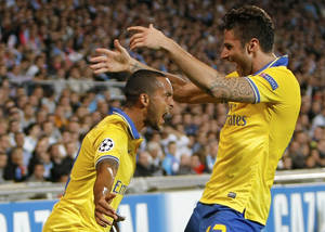 Photo - Arsenal's forward Theo Walcott, left, celebrates his goal with Arsenal's French forward Olivier Giroud,  after scoring against Marseille, during their Champions League Group F soccer match, at the Velodrome Stadium, in Marseille, southern France, Wednesday, Sept. 18, 2013. (AP Photo/Claude Paris)