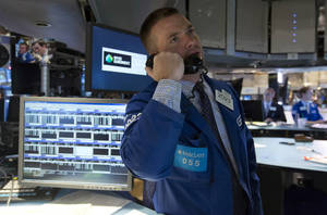 Photo - In this Tuesday, Aug. 27, 2013 photo, specialist Frank Masiello works at his post on the floor of the New York Stock Exchange. U.S. stock futures are rising, Monday, Sept. 9, 2013, on promising economic data out of Asia. (AP Photo/Richard Drew)
