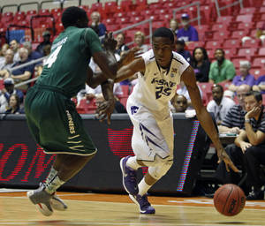 Photo - Charlotte guard Terrence Williams, left, pressures Kansas State forward Wesley Iwundu during a NCAA college basketball game in San Juan, Puerto Rico, Thursday, Nov. 21, 2013. (AP Photo/Ricardo Arduengo)