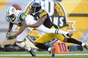 Photo -   Pittsburgh Steelers free safety Ryan Clark (25) holds on to New York Jets wide receiver Stephen Hill (84) after breaking up a pass in the second quarter of an NFL football game, Sunday, Sept. 16, 2012, in Pittsburgh. (AP Photo/Don Wright)