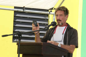 "Photo - FILE - In this Nov. 8, 2012 file photo, John McAfee speaks at a ceremony for the official presentation of equipment at the San Pedro Police Station in Ambergris Caye, Belize.  McAfee, 67, has been identified as a ""person of interest"" in the killing of his neighbor, 52-year-old Gregory Faull. Police are urging McAffe to come in for questioning. The anti-virus company founder  said on Monday, Dec. 3, 2012, he has left Belize and is still on the run, hiding from police out of fear they want to kill him.  (AP Photo/Ambergris Today Online-Sofia Munoz, File)"