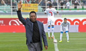 Photo - Former Brazilian soccer star Pele waves to the crowd before the kick off of the friendly soccer match Algeria vs Slovenia at Blida stadium, Algeria, Wednesday, March 5 , 2014. The match takes place ahead of the 2014 FIFA World Cup starting next June. (AP Photo/Sidali Djarboub)