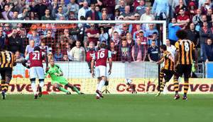 Photo - Hull City's Robbie Brady, second right,  scores a penalty past West Ham's Jussi Jaaskelainen during their English Premier League match at the KC Stadium, in Hull, England, Saturday Sept. 28, 2013. (AP Photo/PA, Lynne Cameron) UNITED KINGDOM OUT