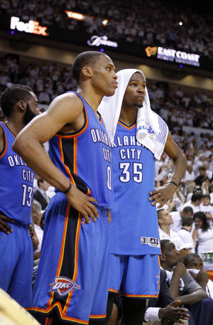 photo - Oklahoma City's Kevin Durant (35) and Oklahoma City's Russell Westbrook (0) watch the final minutes of Game 5 of the NBA Finals between the Oklahoma City Thunder and the Miami Heat at American Airlines Arena, Thursday, June 21, 2012. Oklahoma City lost 121-106. Photo by Bryan Terry, The Oklahoman
