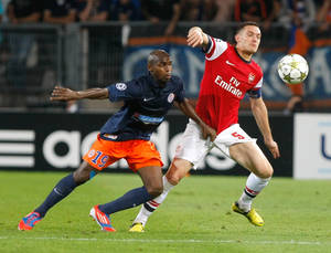 Photo -   Montpellier's Senegalese forward Souleymane Camara, left, challenges for the ball with Arsenal's Belgian defender Thomas Vermaelen, during the Champions League Group B soccer match between Montpellier and Arsenal, at the La Mosson stadium, in Montpellier, southern France, Tuesday, Sept.18, 2012. (AP Photo/Claude Paris)