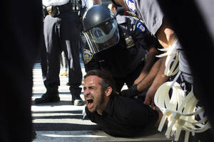 photo -   Occupy Wall Street protestor Chris Philips screams as he is arrested near Zuccotti Park, Monday, Sept. 17, 2012, in New York. Multiple Occupy Wall Street protestors have been arrested during a march toward the New York Stock Exchange on the anniversary of the grass-roots movement. (AP Photo/John Minchillo)