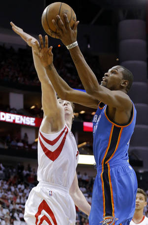 Photo - Oklahoma City's Kevin Durant (35) goes past Houston's Omer Asik (3) during Game 3 in the first round of the NBA playoffs between the Oklahoma City Thunder and the Houston Rockets at the Toyota Center in Houston, Texas, Sat., April 27, 2013. Photo by Bryan Terry, The Oklahoman