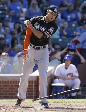 Photo - Miami Marlins' Giancarlon Stanton throws his bat after striking out during the third inning of a baseball game against the Chicago Cubs in Chicago, Friday, June 6, 2014. (AP Photo/Nam Y. Huh)