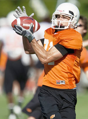 Photo - Oklahoma State's Colton Chef catches a pass during the Cowboys' practice Friday in Stillwater. OSU is looking for another go-to receiver. (Photo by Bryan Terry, The Oklahoman)