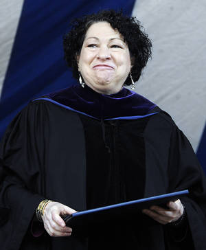 Photo - File-In this May 20, 2013,  file photo, Supreme Court Justice Sonia Sotomayor smiles after receiving a Honorary Doctor of Laws during commencement at Yale University in New Haven, Conn. But for the first time in a decade, a New York City mayor won't be attending the countdown at the crossroads of the world. Outgoing Mayor Michael Bloomberg said he's sitting this year out to spend time with family. And Mayor-elect Bill de Blasio will be sworn into office at a private ceremony at 12:01 a.m. Instead, Sotomayor will lead the 60-second countdown and push the ceremonial button to signal the descent of the Times Square New Year's Eve ball. (AP Photo/Jessica Hill, File)