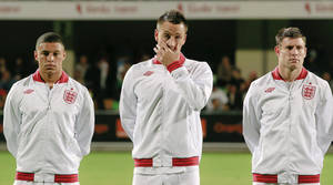 photo -   England's John Terry, center, Alex Oxlade Chamberlain, left, and James Milner line up in Chisinau, Moldova, Friday, Sept. 7, 2012 before their Group H FIFA World Cup qualifier soccer match against Moldova. (AP Photo/Vadim Ghirda)