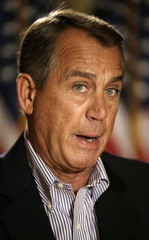 Photo - House Speaker John Boehner of Ohio speaks during a news conference on Capitol Hill in Washington, Friday, Dec. 7, 2012, to discuss the pending fiscal cliff.  Boehner said there's been no progress in negotiations on how to avoid the fiscal cliff of tax hikes and spending cuts and called on President Barack Obama to come up with a new offer.  (AP Photo/Pablo Martinez Monsivais)