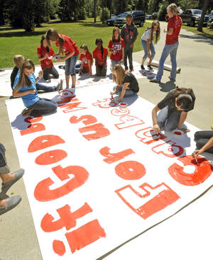 Photo -   Kountze High School cheerleaders and other children work on a large sign Wednesday, Sept. 19, 2012 in Kountze, Texas. The small Hardin County community is rallying behind the high school's cheerleaders after the squad members were told they could not use scripture verses on their signs at the football games. (AP Photo/The Beaumont Enterprise, Dave Ryan)