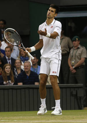 Photo - Novak Djokovic of Serbia gestures after a line call during his men's singles match against Jo-Wilfried Tsonga of France at the All England Lawn Tennis Championships in Wimbledon, London, Monday, June 30, 2014. (AP Photo/Pavel Golovkin)