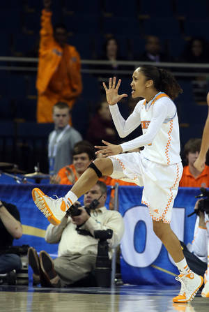 Photo - Tennessee guard Meighan Simmons celebrates after scoring the go-ahead basket late in the second half against LSU in an NCAA college basketball game in the quarterfinals of the Southeastern Conference women's tournament, Friday, March 7, 2014, in Duluth, Ga. Tennessee won 77-65. (AP Photo/Jason Getz)