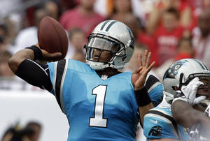 photo -   Carolina Panthers quarterback Cam Newton throws a pass during the first quarter of an NFL football game against the Tampa Bay Buccaneers, Sunday, Sept. 9, 2012, in Tampa, Fla. (AP Photo/Chris O&#039;Meara)  