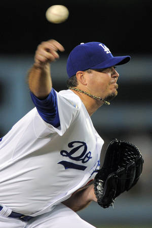 Photo -   Los Angeles Dodgers starting pitcher Josh Beckett throws to the plate during the first inning of their baseball game against the St. Louis Cardinals, Thursday, Sept. 13, 2012, in Los Angeles. (AP Photo/Mark J. Terrill)