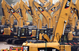 Photo - FILE - This Thursday, Feb. 28, 2013, file photo shows a parking lot at Caterpillar Belgium, in Gosselies, Belgium. Caterpillar Inc. reports quarterly financial results before the market opens on Monday, Jan. 27, 2014. (AP Photo/Yves Logghe, File)