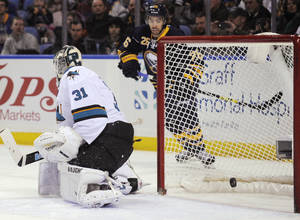 Photo - San Jose Sharks goaltender Antti Neimi (31), of Finland, is scored on by Buffalo Sabres' Cody Hodgson, not seen, as Sabres left winger Matt Moulson (26) watches during the first period of an NHL hockey game in Buffalo, N.Y., Friday, Feb. 28,  2014. (AP Photo/Gary Wiepert)