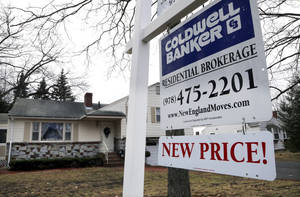 photo - FILE - In this Thursday, Dec. 20, 2012, file photo, a sign hangs in North Andover, Mass.  U.S. sales of previously occupied homes dipped in December from November, in part because of a limited supply of available homes. But for all of 2012, sales rose to their highest level in five years, (AP Photo/Elise Amendola, File)