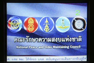 Photo - This photo taken off the TV screen shows the blue screen with military crests that replaced all TV programming in Thailand Friday, May 23, 2014. Thailand's junta has commandeered every TV channel for round-the-clock broadcasts of dour announcements and patriotic hymns. The public's verdict: DJ, please change the soundtrack. (AP Photo/Apichart Weerawong)