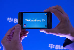 photo - CORRECTS PHONE MODEL NAME TO Z10 INSTEAD OF 10 - Arun Kumar, a senior product manager for BlackBerry, shows off the new BlackBerry Z10 during the global launch of the new Blackberry smartphones in Toronto on Wednesday, Jan. 30, 2013. BlackBerry is promising a speedy browser, a superb typing experience and the ability to keep work and personal identities separate on the same phone, the fruit of a crucial, long-overdue makeover for the company. (AP Photo/The Canadian Press, Nathan Denette)