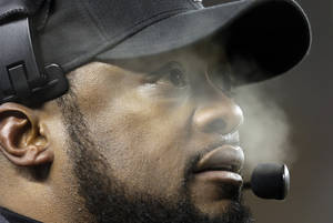 Photo - Pittsburgh Steelers head coach Mike Tomlin watches his team in the first half of an NFL football game between the Steelers and the Cincinnati Bengals on Sunday, Dec. 15, 2013, in Pittsburgh. (AP Photo/Gene J. Puskar)